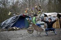 Kurdish children playing, Squalid conditions, Grande-Synthe refugee camp Dunkirk, France. - Jess Hurd - ,2010s,2016,BME black,boy,boys,camp,camps,child,CHILDHOOD,children,Diaspora,displaced,ethnic,ETHNICITY,eu,Europe,european,europeans,europeregi,eurozone,foreign,foreigner,foreigners,france,France.,fren
