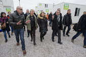 Mayor of Calais Natacha Bouchart and other politicians visit refugees in shipping container accommodation inside the Jungle camp. Calais, France. - Jess Hurd - 21-02-2016
