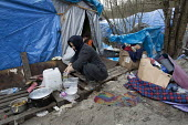 Squalid conditions in the Grande-Synthe refugee camp. Dunkirk, France. - Jess Hurd - 2010s,2016,BAME,BAMEs,Black,BME,bmes,Calais,camp,camps,Diaspora,dirty,displaced,diversity,ethnic,ethnicity,eu,Europe,european,europeans,europeregi,eurozone,FEMALE,foreign,foreigner,foreigners,France,f