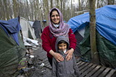 Shoxan and Zhulen (6) from Kurdistan existing in squalid conditions in the Grande-Synthe refugee camp.Dunkirk, France. - Jess Hurd - 24-02-2016