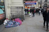 Two homeless rough sleepers and pedestrians, Piccadilly Circus, London - Philip Wolmuth - 14-02-2016