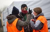 The Prefecture tell refugees to leave the makeshift Jungle camp prior to a demolition planned by French authorities. Calais, France. - Jess Hurd - 26-02-2016