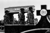 Masked IRA volunteers carrying the coffin of Bobby Sands 1981 who died after 66 days on hunger strike in protest at the removal of Special Category (political prisoner) status for Irish Republican pri... - Katalin Arkell - 1980s,1981,activist,activists,against,Belfast,Bobby Sands,CAMPAIGNING,CAMPAIGNS,carries,carry,carrying,casket,catholic,catholics,cemeteries,Cemetery,cities,city,coffin,coffin bearing,Conflict,Conflict