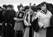 Funeral of the IRA prisoner Bobby Sands, 1981. Mourners carry black flags, Milltown Cemetery, Belfast, Northern Ireland - Katalin Arkell - 1980s,1981,Belfast,black flags,Bobby Sands,catholic,catholics,cemeteries,Cemetery,cities,city,conflict,DEATH,DEATHS,died,disputes,europeregi,FEMALE,FLAG,flags,funeral,FUNERALS,grave,graves,graveyard,g