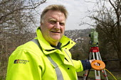 Mick Upfield working for Ordinance Survey, High Wickham. Mick Upfield working for Ordnance Survey, High Wickham - Jess Hurd - 2010s,2013,europeregi,horizontal and vertical angles,instruments,male,man,MEASURE,MEASUREMENT,measuring,member,member members,members,men,older,people,person,persons,sct,surveying,surveying instrument