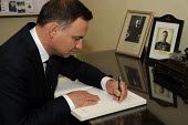 Polish President Andrzej Duda signing the official visitors book at the Polish Institute aand Sikorski Museum, (PISM) London. - Janina Struk - 15-09-2015
