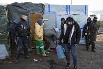 Demolition of the makeshift Jungle refugee camp, Calais, France - Jess Hurd - 2010s,2016,adult,adults,authorities,BAME,BAMEs,Black,BME,bmes,Calais,camp,camps,CLJ,CRS,DEMOLISH,DEMOLISHED,demolition,developer,developers,DEVELOPMENT,Diaspora,displaced,diversity,ethnic,ethnicity,eu