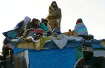 Demolition of the makeshift Jungle refugee camp, Calais, France - Jess Hurd - 2010s,2016,adult,adults,authorities,BAME,BAMEs,Black,BME,bmes,Calais,camp,camps,CLJ,cold,CRS,DEMOLISH,DEMOLISHED,demolition,developer,developers,DEVELOPMENT,Diaspora,displaced,diversity,ethnic,ethnici