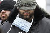 Iranian asylum seekers with stitched up mouths in protest at not beening heard by French authorities demolishing the makeshift Jungle refugee camp. Calais, France. - Jess Hurd - 02-03-2016
