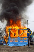 Shacks burning down, demolition of the Jungle refugee camp, Calais, France - Jess Hurd - 02-03-2016