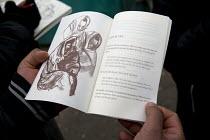 Artist sketching refugees, demolition of the Jungle refugee camp, Calais, France - Jess Hurd - 2010s,2016,ACE,art,artist,artists,arts,artwork,artworks,authorities,BAME,BAMEs,BME,BME black,bmes,Calais,camp,camps,culture,DEMOLISH,DEMOLISHED,demolition,developer,developers,DEVELOPMENT,Diaspora,dis