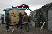 Activists occupy rooftops, demolition of the makeshift Jungle refugee camp, Calais, France - Jess Hurd - 2010s,2016,activist,activists,authorities,BAME,BAMEs,BME,BME black,bmes,Calais,camp,CAMPAIGN,campaigner,campaigners,CAMPAIGNING,CAMPAIGNS,camps,DEMOLISH,DEMOLISHED,demolition,DEMONSTRATING,Demonstrati
