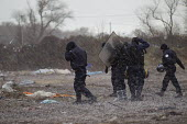 CRS riot police caught in a hailstorm, demolition of the makeshift Jungle refugee camp, Calais, France - Jess Hurd - 02-03-2016