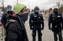 CRS riot police. Demolition of the Jungle refugee camp, Calais, France - Jess Hurd - CLJ,2010s,2016,adult,adults,authorities,BAME,BAMEs,BME,BME black,bmes,Calais,camp,camps,CRS,DEMOLISH,DEMOLISHED,demolition,developer,developers,DEVELOPMENT,Diaspora,displaced,diversity,ethnic,ethnicit