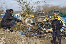 CRS riot police. Demolition of the Jungle refugee camp, Calais, France - Jess Hurd - 2010s,2016,African,Africans,authorities,BAME,BAMEs,Black,BME,BME black,bmes,Calais,camp,camps,DEMOLISH,DEMOLISHED,demolition,developer,developers,DEVELOPMENT,Diaspora,displaced,diversity,ethnic,ethnic