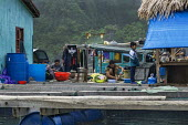 Floating fishing village, Ha Long Bay, North Vietnam - David Bacon - 2010s,2015,Asia,asian,asians,asiaregi,bay,boat,boats,boy,boys,child,CHILDHOOD,children,EBF,Economic,Economy,employee,employees,Employment,fish,fisheries,FISHERMAN,fishermen,fishery,FISHES,fishing,Fish