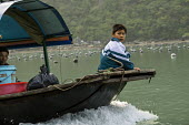 Fishing boat, Ha Long Bay, North Vietnam - David Bacon - 2010s,2015,Asia,asian,asians,asiaregi,bay,boat,boats,boy,boys,child,child labor,CHILDHOOD,children,DAD,DADDIES,DADDY,DADS,EBF,Economic,Economy,employee,employees,Employment,families,family,father,FATH