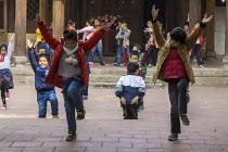 School children exercising, Hanoi, Vietnam - David Bacon - 2010s,2015,Asia,asian,asians,asiaregi,boy,boys,child,CHILDHOOD,children,dance,DANCER,DANCERS,DANCING,EDU,educate,educating,Education,educational,exercise,exercises,exercising,female,females,girl,GIRLS