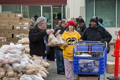 Detroit, Michigan, Volunteers at the Arab American and Chaldean Council distributing food to the hungry in its twice monthly Pantry of Plenty program - Jim West - ,2010s,2016,African American,African Americans,aid,America,arab,Arab American,arabs,assistance,BAME,BAMEs,black,BME,bmes,Chaldean,charitable,charity,community service,Council,Detroit,distributing,dist