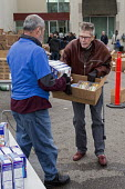 Detroit, Michigan, Volunteers at the Arab American and Chaldean Council distributing food to the hungry in its twice monthly Pantry of Plenty program - Jim West - 2010s,2016,age,ageing population,aid,America,arab,Arab American,arabs,assistance,Chaldean,charitable,charity,community service,Council,Detroit,distributing,distribution,elderly,EQUALITY,excluded,exclu