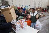 Detroit, Michigan, Volunteers at the Arab American and Chaldean Council distributing food to the hungry in its twice monthly Pantry of Plenty program - Jim West - ,2010s,2016,African American,African Americans,African-American,aid,America,arab,Arab American,arabs,assistance,BAME,BAMEs,black,BME,bmes,Chaldean,charitable,charity,community service,Council,Detroit,