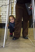 Detroit, Michigan, toddler as his mother votes in the primary presidential election. - Jim West - 08-03-2016