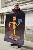 Artist Kaya Mar with satirical painting of Chancellor George Osborne and 2016 Budget, Westminster, London - Jess Hurd - 2010s,2016,ACE,art,artist,artists,arts,artwork,artworks,culture,George Osborne,London,painter,painters,painting,paintings,POL Politics,satire,satirist,satirists,Westminster
