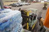 Flint, Michigan, Christian volunteers distributing bottled water to residents. The citys water supply became unsafe after it was contaminated with lead - Jim West - 12-03-2016