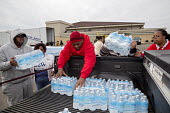 Flint, Michigan, residents collecting bottled water. The city's water supply became unsafe after it was contaminated with lead - Jim West - ,&, American,2010s,2016,African American,African Americans,America,American,americans,BAME,BAMEs,Baptist,Belief,black,BME,bmes,bottle,bottled water,bottles,charitable,charity,christian,christianity,ch