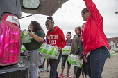 Flint, Michigan, residents collecting bottled water. The city's water supply became unsafe after it was contaminated with lead - Jim West - 12-03-2016