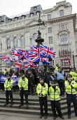 Britain First nationalists countering Stand Up to Racism National Demonstration - Refugees Welcome, Stand Up to Racism, Islamaphobia, anti-Semitism and fascism. Eros, Piccadily Circus. Central London. - Jess Hurd - 19-03-2016