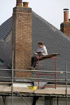 Construction worker pointing the bricks of a house chimney, Warwickshire - John Harris - 29-01-2016