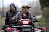 Farmer with his dog a quad bike, Warwickshire - John Harris - 2010s,2016,age,ageing population,agricultural,agriculture,animal,animals,bike,bikes,canine,capitalism,capitalist,dog,dogs,driver,drivers,driving,EBF,Economic,Economy,elderly,farm,Farm Worker,farm work