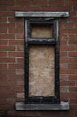 Boarded up window of a burnt out house, Easington Lane, Hetton, Tyne and Wear - John Harris - 2010s,2016,accident,accidental,accidents,burnt,burnt out,communities,community,derelict,DERELICTION,DIA,fire,fires,house,houses,Housing,Housing Estate,incident,incidents,people,rural,scene,scenes,stre