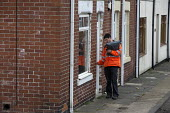 Postal worker deliverying the post, Easington Lane, Hetton, Tyne and Wear - John Harris - 2010s,2016,communicating,communication,deliver,deliveries,DELIVERING,delivery,delivery round,employee,employees,Employment,home,homes,house,houses,Housing,Housing Estate,job,jobs,LBR,letter,letters,MA