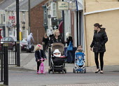 Mothers and children, Easington Lane, Hetton, Tyne and Wear - John Harris - 2010s,2016,adult,adults,babies,baby,child,CHILDHOOD,children,communities,community,cross,Crossing The Road,EARLY YEARS,families,FAMILY,female,females,girl,girls,infancy,infant,infants,juvenile,juvenil