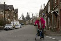 Elderly woman, Port Talbot steelworks, South Wales - John Harris - 04-04-2016