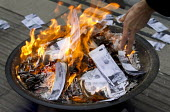 Lesbian and Gay Support the Migrants burn 35,000 pounds of Theresa May fake bank notes printed with the face of Theresa May in protest over a new law today that will force thousands of non-EU migrants... - Jess Hurd - 06-04-2016