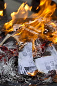 Lesbian and Gay Support the Migrants campaigners burn 35,000 pounds of fake bank notes printed with the face of Theresa May in protest over a new law today that will force thousands of non-EU migrants... - Jess Hurd - 06-04-2016