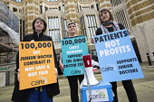 Junior doctors protesting outside the Department of Health on a 48h strike deliver a Care2 petition. Westminster, London. - Jess Hurd - 06-04-2016