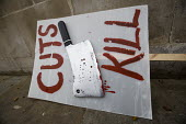 Cuts Kill placard. Junior doctors protesting outside the Department of Health on a 48h strike. Organised by the People's Assembly. Westminster, London. - Jess Hurd - 06-04-2016