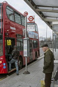 Elderly man waiting at a bus stop, Shepherds Bush, London - Philip Wolmuth - 2010s,2016,adult,adults,age,aged,ageing population,bus,bus service,bus stop,buses,cities,City,EBF,Economic,Economy,elderly,For,highway,journey,journeys,London,male,man,MATURE,men,Metroline,OAP,OAPS,ol