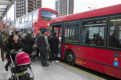 Boarding buses at a bus stop, Shepherds Bush, London - Philip Wolmuth - 16-03-2016