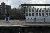 Woman waiting for a train, Battersea Park railway station plaform, London. - Philip Wolmuth - 31-03-2016