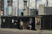 Bus stop in the 480 acre Nine Elms regeneration zone, London. The zone will include two new tube stations, a new US Embassy building, and 20,000 new homes with prices up to 9 million. - Philip Wolmuth - 2010s,2016,apartment,apartments,Bellway,brownfield site,building,building site,buildings,bus,bus service,bus stop,buses,Carillion,cities,City,construction,Construction Industry,CRANE,cranes,developer,