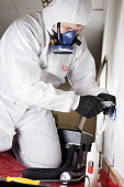 Asbestos removal, Santia, Health, Safety and Environmental Consultancy - Paul Box - 2010s,2012,Asbestos,ASBESTOSIS,Breathing Apparatus,by hand,employee,employees,Employment,hazard,hazardous,hazards,health,job,jobs,LBR,male,man,mask,masked,masks,men,Oxygen Mask,people,person,persons,P