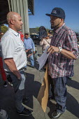 California, Ramon Torres president of FUJ confronting the store manager. California, Farm workers protest at Costco, demanding that the chain stop selling Driscoll's Berries because they are produced... - David Bacon - 25-03-2016