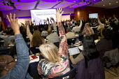 Delegates voting at TUC Black Workers' Conference. Congress House. London. - Jess Hurd - 2010s,2016,BAME,BAMEs,Black,Black TUCs Conference,BME,bmes,conference,conferences,Congress House,delegate,delegates,democracy,diversity,ethnic,ethnicity,FEMALE,Hands up,London.,member,member members,m