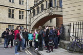 Tourist guide showing tourists around Oxford, Hertford College Bridge,known as the Bridge of Sighs, University of Oxford - John Harris - 16-04-2016