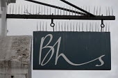 Dilapidated sign outside BHS Store Stratford-upon-Avon Warwickshire. 11,000 jobs go as Retail Acquisitions put the department store into administration - John Harris - 24-04-2016